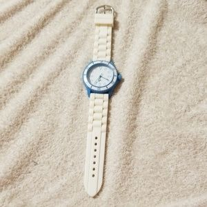 Teal and white watch with white band by Avon.